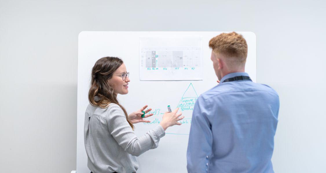 woman explainings something on a whiteboard
